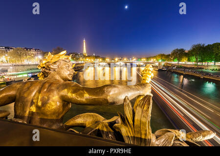 France, Paris, Eiffel Tower, View from Pont Alexandre III bridge, Seine river, bronze sculpture at blue hour - Stock Photo