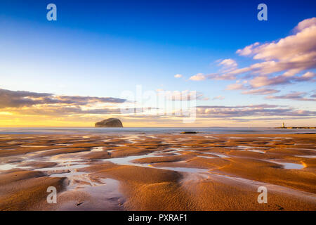 UK, Scotland, East Lothian, North Berwick, Firth of Forth, view of Bass Rock (world famous Gannet Colony) at sunset, Lighthouse, sand, beach - Stock Photo