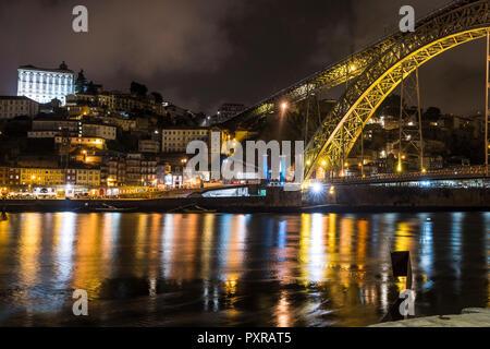 Portugal, Porto, view to the city and Ponte Luiz I Bridge over Douro river at night - Stock Photo