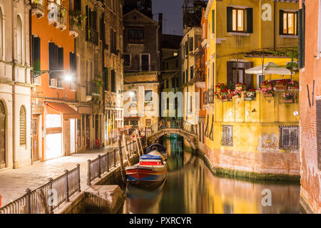 Italy, Venice, Canal and houses at night - Stock Photo