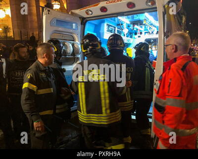 Rome, Italy. 23rd Oct, 2018. ROME, ITALY - OCTOBER 23, 2018: Firefighters and emergency service workers outside the Repubblica underground station; some 30 people including CSKA Moscow fans from Russia have been injured in an escalator accident at the Repubblica underground station; Rome is hosting a UEFA Champions League Group Stage football match between CSKA Moscow and Roma. Vera Shcherbakova/TASS Credit: ITAR-TASS News Agency/Alamy Live News - Stock Photo