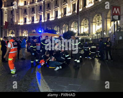 Rome, Italy. 23rd Oct, 2018. ROME, ITALY - OCTOBER 23, 2018: Paramedics and firefighters help injured people outside the Repubblica underground station; some 30 people including CSKA Moscow fans from Russia have been injured in an escalator accident at the Repubblica underground station; Rome is hosting a UEFA Champions League Group Stage football match between CSKA Moscow and Roma. Vera Shcherbakova/TASS Credit: ITAR-TASS News Agency/Alamy Live News - Stock Photo