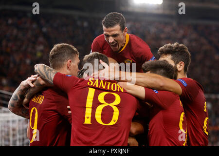 Rome, Italy, 23rd October, 2018. Roma's Edin Dzeko, left, celebrates with his teammates after scoring during the Champions League Group G soccer match between Roma and CSKA Moscow at the Olympic Stadium. Roma won 3-0. © Riccardo De Luca UPDATE IMAGES/ Alamy Live News - Stock Photo