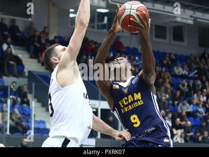 Nizhny Novgorod, Russia. 23rd Oct, 2018. Dmitrii Uzinskii (BCNN) and Charlon Kloof (UCAM) seen in action during the game.Basketball Champions League. BCNN Met BC Nizhny Novgorod (Russia) vs UCAM Murcia Spain. The game ended with the score 51: 72. Credit: Aleksey Fokin/SOPA Images/ZUMA Wire/Alamy Live News