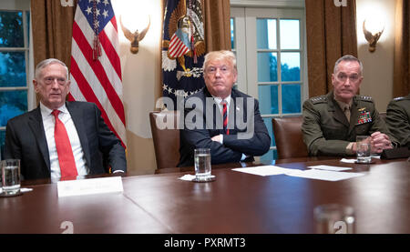 United States President Donald J. Trump, center, makes a statement to the media as he prepares to receive a briefing from senior military leaders in the Cabinet Room of the White House in Washington, DC on Tuesday, October 23, 2018. The President took questions on the proposed space force, immigration, the caravan and Saudi actions in the killing of Jamal Khashoggi. At left is US Secretary of Defense James Mattis and at right is US Marine Corps General Joseph F. Dunford, Chairman of the Joint Chiefs of Staff. Credit: Ron Sachs/Pool via CNP | usage worldwide - Stock Photo
