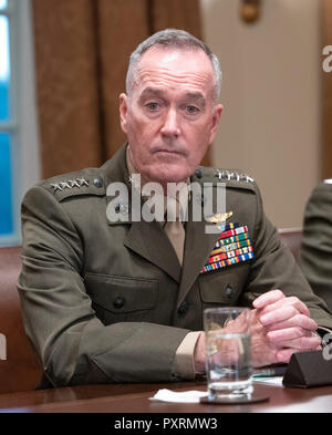United States Marine Corps General Joseph F. Dunford, Chairman of the Joint Chiefs of Staff listens as US President Donald J. Trump makes a statement to the media as he prepares to receive a briefing from senior military leaders in the Cabinet Room of the White House in Washington, DC on Tuesday, October 23, 2018. The President took questions on the proposed space force, immigration, the caravan and Saudi actions in the killing of Jamal Khashoggi. Credit: Ron Sachs/Pool via CNP | usage worldwide - Stock Photo