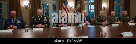 United States President Donald J. Trump makes a statement to the media as he prepares to receive a briefing from senior military leaders in the Cabinet Room of the White House in Washington, DC on Tuesday, October 23, 2018. The President took questions on the proposed space force, immigration, the caravan and Saudi actions in the killing of Jamal Khashoggi. From left to right: US Air Force General Joseph L. Lengyel, Chief of the National Guard Bureau; US Army General Mark A. Milley, Chief of Staff of the Army; US Secretary of Defense James Mattis; the President; US Marine Corps General Josep - Stock Photo