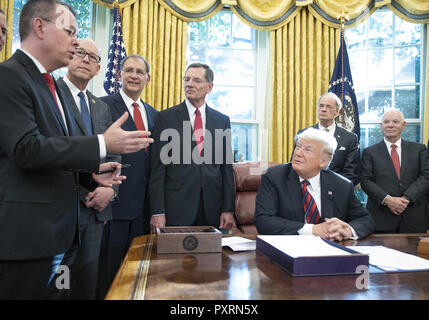 October 23, 2018 - Washington, District of Columbia, U.S. - Pastor Andrew Brunson, left, makes a statement after United States President Donald J. Trump signed S.3021, America's Water Infrastructure Act of 2018 in the Oval Office of the White House in Washington, DC on Tuesday, October 23, 2018. After signing the bill, the President took questions from the pool on the caravan and Saudi Arabia. Also pictured from left to right: US Representative Greg Walden (Republican of Oregon), US Senator John Boozman (Republican of Arkansas), US Senator John Barrasso (Republican of Wyoming), US Senator To - Stock Photo