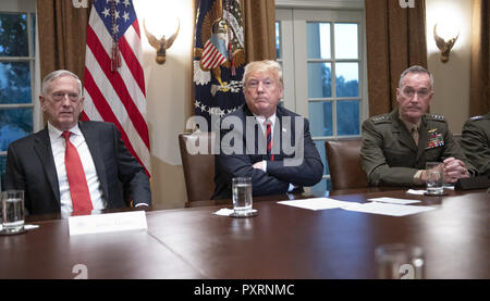 October 23, 2018 - Washington, District of Columbia, U.S. - United States President Donald J. Trump, center, makes a statement to the media as he prepares to receive a briefing from senior military leaders in the Cabinet Room of the White House in Washington, DC on Tuesday, October 23, 2018. The President took questions on the proposed space force, immigration, the caravan and Saudi actions in the killing of Jamal Khashoggi. At left is US Secretary of Defense James Mattis and at right is US Marine Corps General Joseph F. Dunford, Chairman of the Joint Chiefs of Staff (Credit Image: © Ron Sa - Stock Photo
