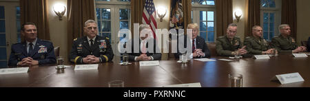 October 23, 2018 - Washington, District of Columbia, U.S. - United States President Donald J. Trump makes a statement to the media as he prepares to receive a briefing from senior military leaders in the Cabinet Room of the White House in Washington, DC on Tuesday, October 23, 2018. The President took questions on the proposed space force, immigration, the caravan and Saudi actions in the killing of Jamal Khashoggi. From left to right: US Air Force General Joseph L. Lengyel, Chief of the National Guard Bureau; US Army General Mark A. Milley, Chief of Staff of the Army; US Secretary of Defens - Stock Photo