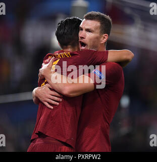 Rome, Italy. 23rd Oct, 2018. As Roma's Edin Dzeko (R) celebrates scoring with Lorenzo Pellegrini during a group G match of UEFA Champions League between Roma and CSKA Moskva, in Rome, Italy, Oct. 23, 2018. Roma won 3-0. Credit: Alberto Lingria/Xinhua/Alamy Live News - Stock Photo