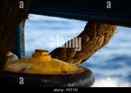 Mooring rope yellow bit on a ferry boat. Selective focus - Stock Photo