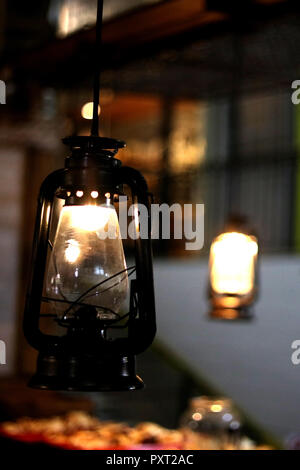 Old lamp hanging on the San Telmo market in Buenos Aires, Argentina - Stock Photo