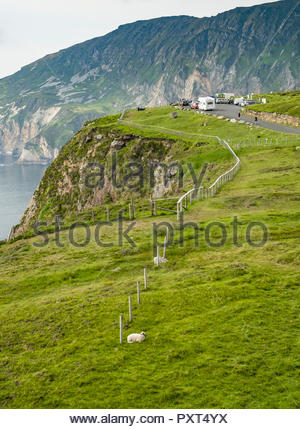 Cars and campervans parked at Bunglass Point with Slieve League Mountain in the background, Sliabh Liag Road, Croaghlin, County Donegal, Ulster, Irela - Stock Photo