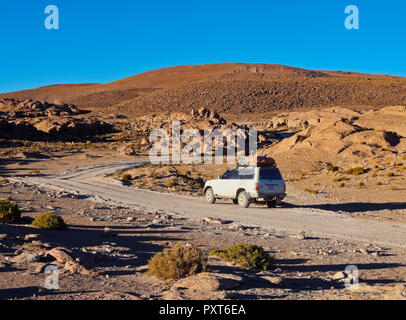 Car in Landscape of the Sierra Quetena, Eduardo Avaroa Andean Fauna National Reserve, Sur Lipez Province, Potosi Departmant - Stock Photo