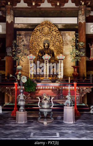Beautiful ancient golden Buddha statue in Butsuden, Buddha Hall, of Daitoku-ji, Japanese Zen Buddhist temple, Kyoto, Japan - Stock Photo