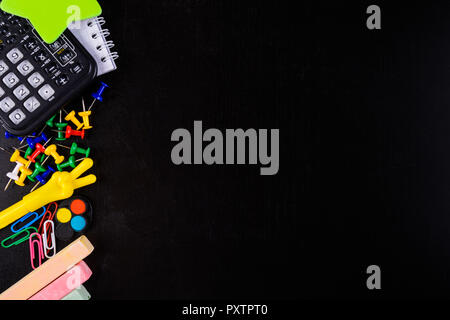 Different stationary on black background with copy space. Back to school concept - Stock Photo