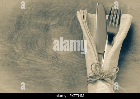 Knife Tied on White Napkin with Empty Tag, on Wooden Table with Text Space. Top view. - Stock Photo