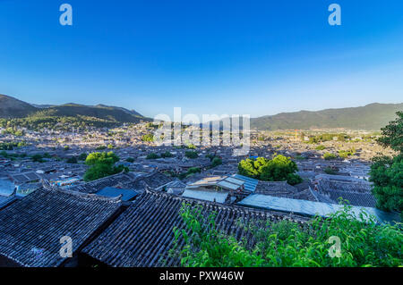 China, Yunnan, Lijiang, tiled roofs in the old town - Stock Photo