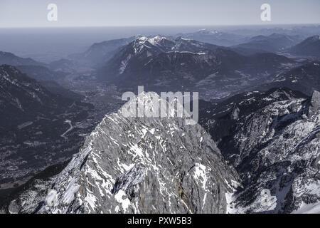 Blick von der Zugspitze ins Alpenvorland und Garmisch Partenkirchen, View from the Zugspitze at the Alpine foothills and Garmisch Partenkirchen, Zugsp - Stock Photo
