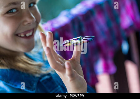 Happy girl with Fidget Spinner - Stock Photo