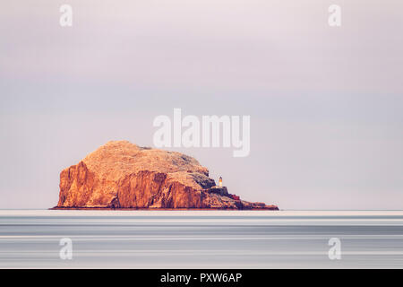 UK, Scotland, East Lothian, North Berwick, Firth of Forth, view of Bass Rock (world famous Gannet Colony), lit by the sunset, Lighthouse, - Stock Photo