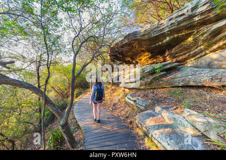 A woman walking along the Hermitage Foreshore Track in  Nielsen Park. Sydney Harbour National Park ,Australia - Stock Photo
