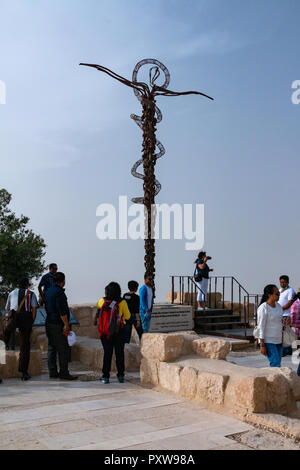 Mount Nebo, Jordan - October 18, 2018: Snake cross sculpture on Mount Nebo in the Holy Land. It was designed by the Italian artist Giovanni Fantoni. - Stock Photo