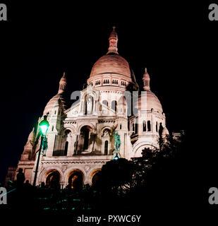 France, Paris, Montmartre, Sacre Coeur by night - Stock Photo