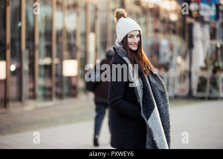 Portrait of fashionable young woman in the city - Stock Photo