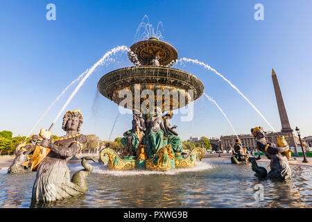 France, Paris, Place de la Concorde, Fountain and Luxor Obelisk - Stock Photo