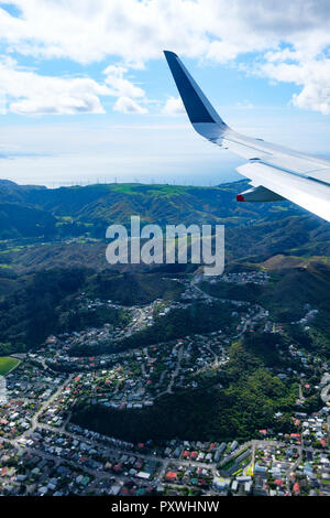 New Zealand's North Island, aerial view from commercial airplane inlcuding segement of aircraft's wing - Stock Photo