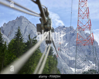 Germany, Bavaria, Garmisch-Partenkirchen, Zugspitze, installers working on poles of a goods cable lift - Stock Photo