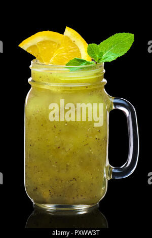 feijoa cocktail with slices of lime and lemon in mason jar mug isolated on black - Stock Photo