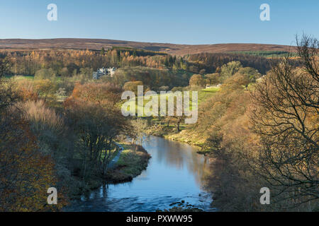 Sunny autumn high view over scenic River Wharfe, looking upstream to Barden Tower ruins & blue sky - Bolton Abbey Estate, Yorkshire Dales, England, UK - Stock Photo