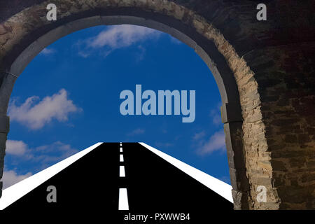 View through a door arch. Asphalt road leads into the blue cloudy sky  Background - Stock Photo