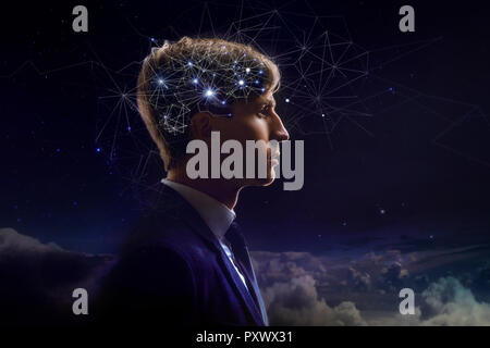 Profile of man with symbol neurons in brain. Thinking like stars, the cosmos inside human, background night sky - Stock Photo