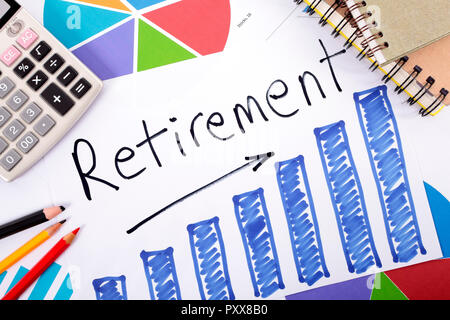 The word Retirement written on a hand drawn bar chart surrounded by pencils, books and calculator. - Stock Photo
