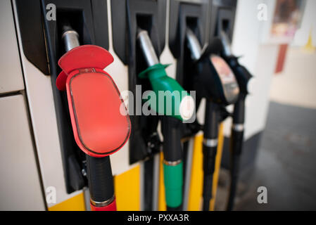 Petrol pump filling nozzles. Fuel at gas station close up - Stock Photo