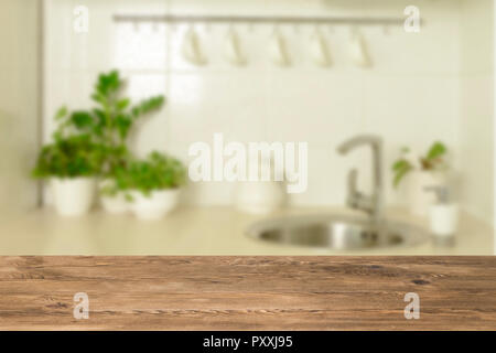 Wooden table top on blur interior background - Stock Photo
