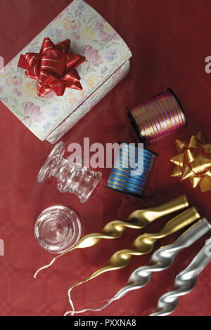 holiday candles gold and silver color glass candle holder with box and ribbons from above - Stock Photo