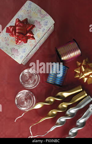 party candles in gold and silver with box and ribbons from above - Stock Photo