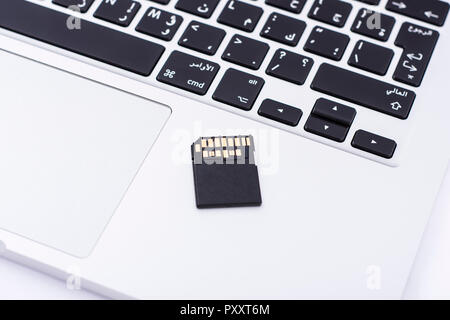Fast SD memory card holding by fingers - Stock Photo