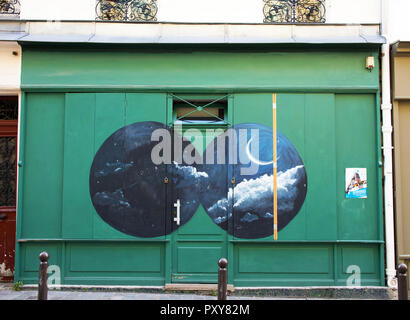 Traditional shop front, painted green and unusual artwork. Rue de Tourtille, Belleville, Paris, France - Stock Photo