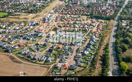 Aerial view of a German suburb with streets and many small houses for families, photographed by a gyrocopter - Stock Photo