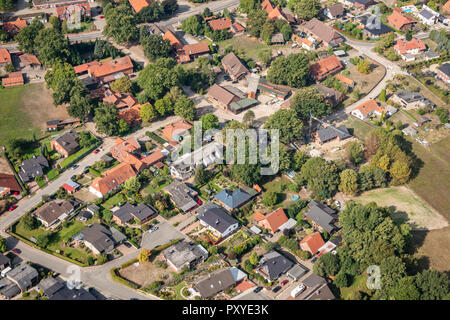 Aerial view of a German suburb with two streets and many small houses for families, photographed by a gyrocopter - Stock Photo