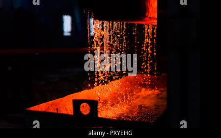 Metal on casting. Metallurgy. Steelmaking plant and steelmaking workshop. Heavy forging Plant.Oven. water curtain. Fire furnace. For abstract backgrou - Stock Photo