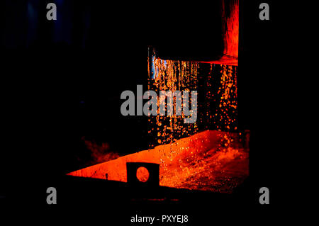 High temperature in the melting furnace. Metallurgical industry. Heavy forging Plant.Oven. Water curtain. For abstract background and texture. - Stock Photo