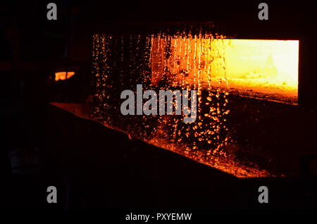 High temperature in the melting furnace. Metallurgical industry. Steelmaking plant and steelmaking workshop. Heavy forging Plant.Oven. Water curtain.  - Stock Photo