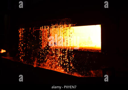 High temperature in the melting furnace. Metallurgical industry. Heavy forging steelmaking plant and steelmaking workshop. Oven. Water curtain. - Stock Photo